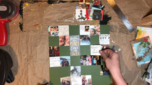 Arranging recycled holiday card squares on a piece of cardstock.