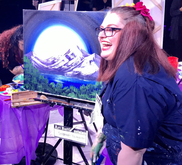 art battle tournament painter with her painting