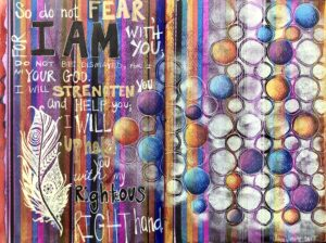 Purple art journal spread with a bible passage