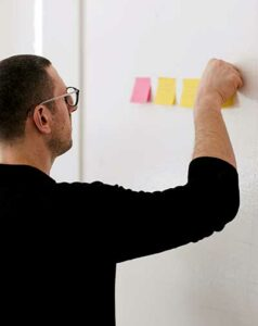 man with goal setting sticky notes